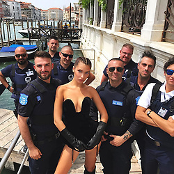 """Bella Hadid releases a photo on Instagram with the following caption: """"got stopped by a lady cop...\ngot me thinkin I could date a cop \ud83d\udea8\ud83d\ude1c\ud83d\udea8"""". Photo Credit: Instagram *** No USA Distribution *** For Editorial Use Only *** Not to be Published in Books or Photo Books ***  Please note: Fees charged by the agency are for the agency's services only, and do not, nor are they intended to, convey to the user any ownership of Copyright or License in the material. The agency does not claim any ownership including but not limited to Copyright or License in the attached material. By publishing this material you expressly agree to indemnify and to hold the agency and its directors, shareholders and employees harmless from any loss, claims, damages, demands, expenses (including legal fees), or any causes of action or allegation against the agency arising out of or connected in any way with publication of the material."""