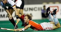 WK Hockey. Nederland-Duitsland 0-1. Teun de Nooijer gaat neer tegen Florian Kunz van Duitsland. Kunz  zorgde voor de enige treffer van de wedstrijd.