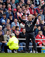 """Photo: Jed Wee.<br />Sunderland v Manchester Utd. The Barclays Premiership. 15/10/2005.<br /><br />Sunderland manager Mick McCarthy responds to Manchester United's fans' chants of """"Mick McCarthy you're a wanker""""."""