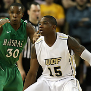 Marshall forward Tirrell Baines (30) and Central Florida forward David Diakite (15) during a Conference USA NCAA basketball game between the Marshall Thundering Herd and the Central Florida Knights at the UCF Arena on January 5, 2011 in Orlando, Florida. Central Florida won the game 65-58 and extended their record to 14-0.  (AP Photo/Alex Menendez)