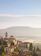 Morning sunrise over the sleepy village of Solomeo in the hills of Umbria, Italy