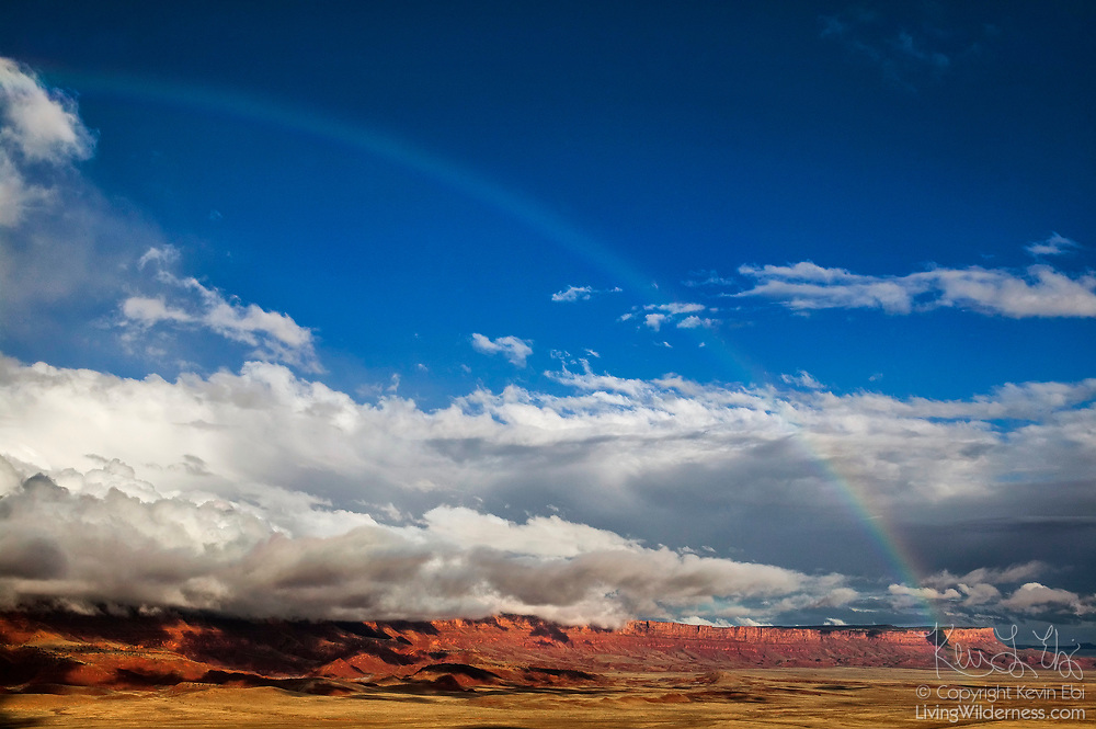 A rainbow stretches across the sky above the Vermilion Cliffs near Page, Arizona. The Vermilion Cliffs, which rise as much as 3,000 feet (914 meters), are the second step in the five-step Grand Staircase of the Colorado Plateau, which stretches from northern Arizona to southern Utah.  The cliffs are made up of sedimentary rocks, primarily sandstone, siltstone, limestone, and shale, that have eroded over millions of years. The Vermilion Cliffs were designated as the Vermilion Cliffs National Monument in 2000.