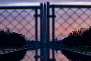WASHINGTON, DC - JANUARY 15: The Washington Monument is seen through security fencing erected around the Reflecting Pool on the morning of January 15, 2021 in Washington, DC. Due to security threats following the January 6th pro-Trump insurrection at the US Capitol, law enforcement agencies moved up security measures along the National Mall and much of downtown Washington, D.C. essentially closing down the Mall a week ahead of President-elect Joe Biden's inauguration.