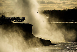 People look at the Canadian side of Niagara Falls from an outlook in Niagara Falls, N.Y., on Thursday, January 10, 2019.Photo by Nathan Denette/CP/ABACAPRESS.COM
