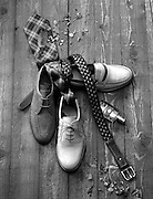 Men's fashion concept. Shoes, belt and tie in black and white