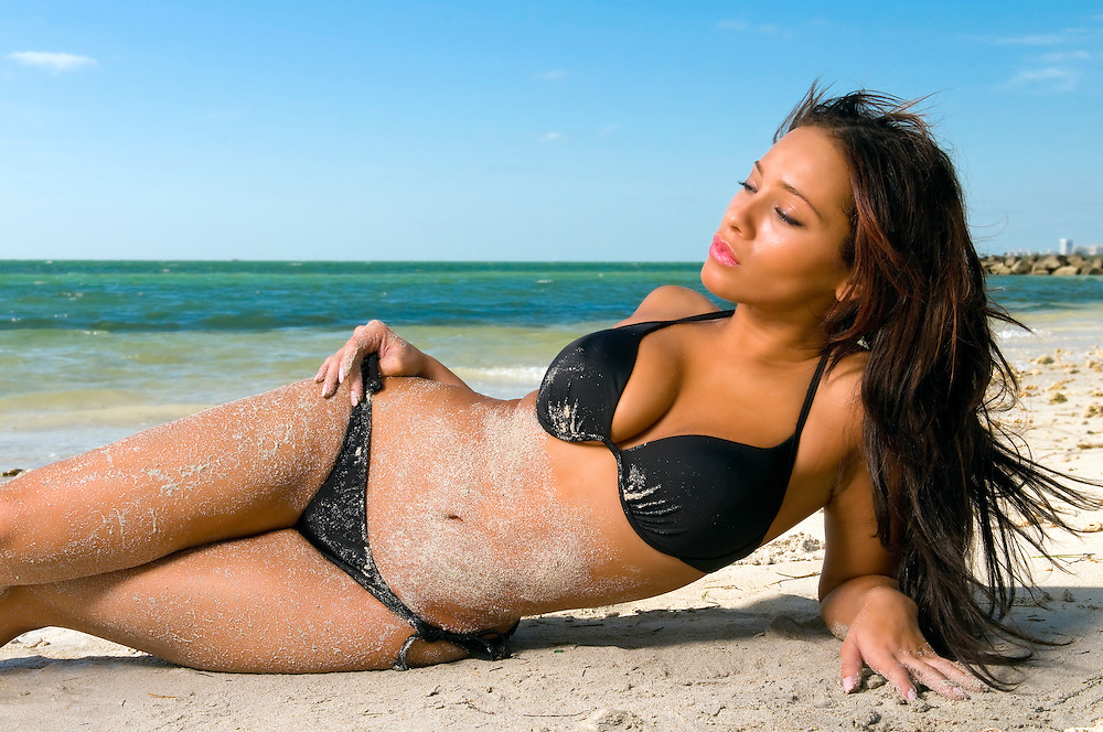 Young  and sensual woman enjoying sunny day on tropical beach