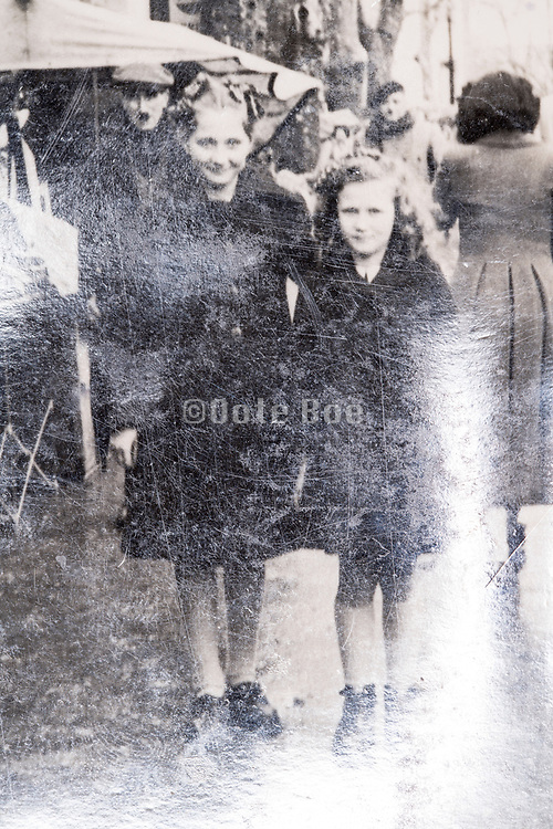 siters together posing in the street France ca 1940s photo with light reflection
