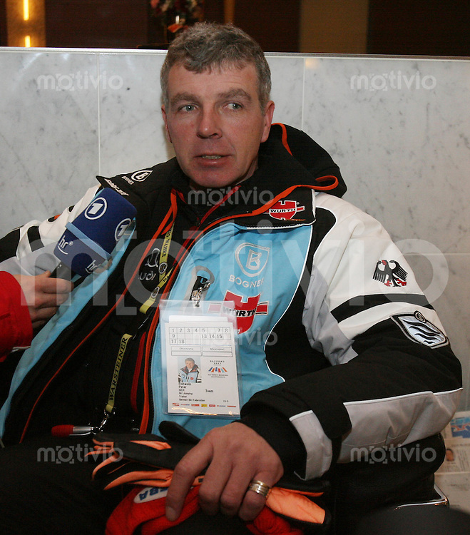 Sapporo , 210207 , Nordische Ski Weltmeisterschaft  Skisprung Bundestrainer Peter ROHWEIN (GER) schaut enttaeuscht waehrend eines ARD Interview als ihm Fragen zum Sturz von Michael UHRMANN (GER) gestellt werden