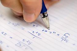 Closeup of University Maths student working,