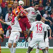 Galatasaray's Umut Bulut (2ndL) and Gaziantepspor's Erdem Sen (L) during their Turkish Super League soccer match Galatasaray between Gaziantepspor at the AliSamiYen Spor Kompleksi TT Arena at Seyrantepe in Istanbul Turkey on Sunday, 26 April 2015. Photo by Kurtulus YILMAZ/TURKPIX
