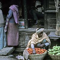 NEPAL, Kathmandu. Vegetable merchant at bazaar.