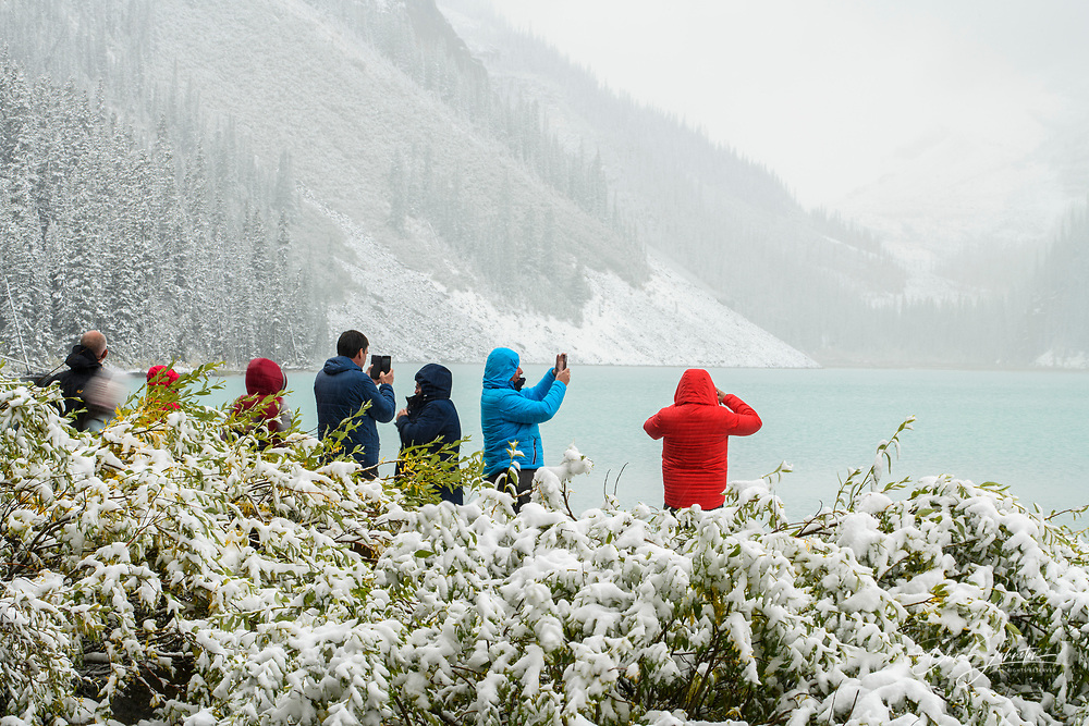 Visitors to Lake Louise ina late summer freak snowstorm, Greater Sudbury, Ontario, Canada