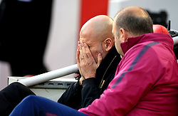 Manchester City manager Pep Guardiola (left) in the dugout before the Premier League match at Anfield, Liverpool.