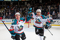 KELOWNA, CANADA - JANUARY 19:  Liam Kindree #26, and Devin Steffler #4 of the Kelowna Rockets celebrate the shootout win against the Prince Albert Raiders on January 19, 2019 at Prospera Place in Kelowna, British Columbia, Canada.  (Photo by Marissa Baecker/Shoot the Breeze)