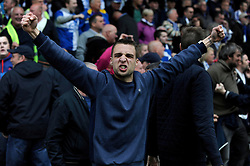 A Bristol Rovers fan celebrates at the final whistle - Photo mandatory by-line: Dougie Allward/JMP - Mobile: 07966 386802 26/04/2014 - SPORT - FOOTBALL - High Wycombe - Adams Park - Wycombe Wanderers v Bristol Rovers - Sky Bet League Two