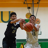 Sheldon Castillo (13) of Tse Yi Gai and Donovan<br /> Saunders (43) of the Hawks, fight for the rebound under the rim on Friday night in Thoreau.