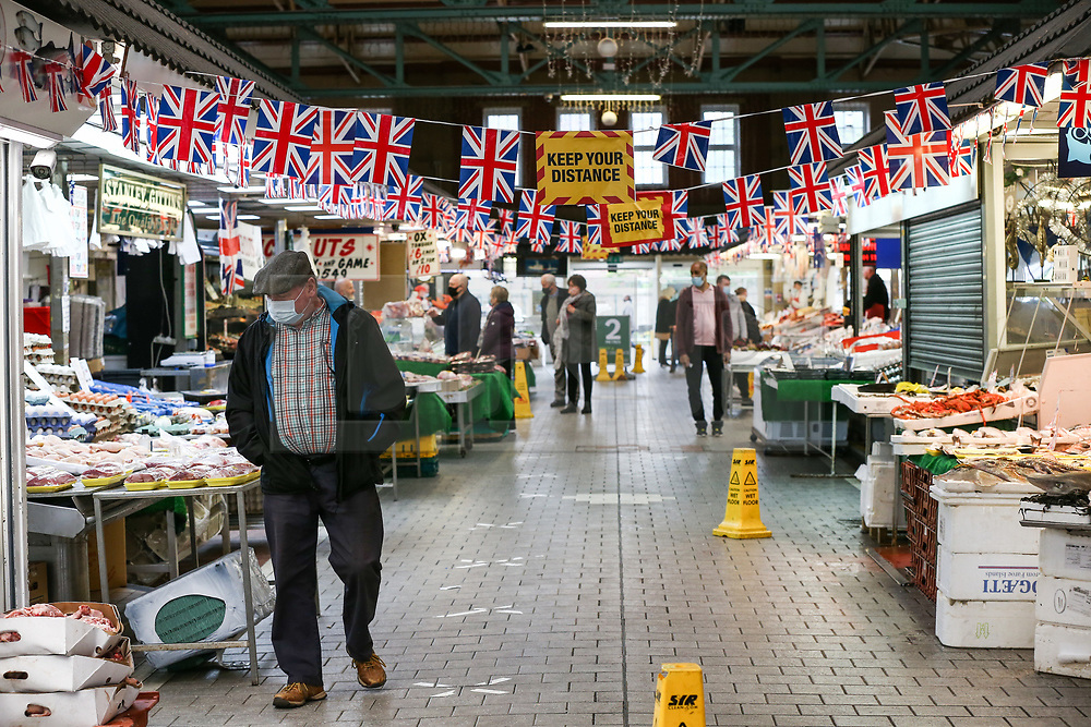 © Licensed to London News Pictures. 14/05/2021. Bolton, UK. Shoppers wear face mask at Bolton Market on Friday morning. Bolton now has the highest infection rate in Britain at 192.3 cases per 100,000. Photo credit: Adam Vaughan/LNP
