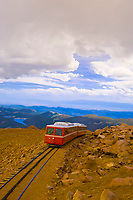 Pikes Peak Cog Railway train starting down from the top of Pikes Peak, Colorado Springs, Colorado USA