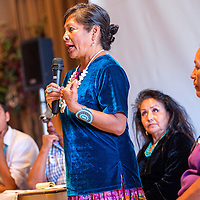 053013       Cable Hoover<br /> <br /> Event organizer Gloria Begay speaks during a panel discussion at a Diné Community Advocates Alliance food forum at Diné College in Tsaile Thursday.