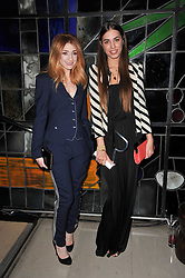 Left to right, NICOLA ROBERTS and AMBER LE BON at the 2nd Rodial Beautiful Awards in aid of the Hoping Foundation held at The Sanderson Hotel, 50 Berners Street, London on 1st February 2011.