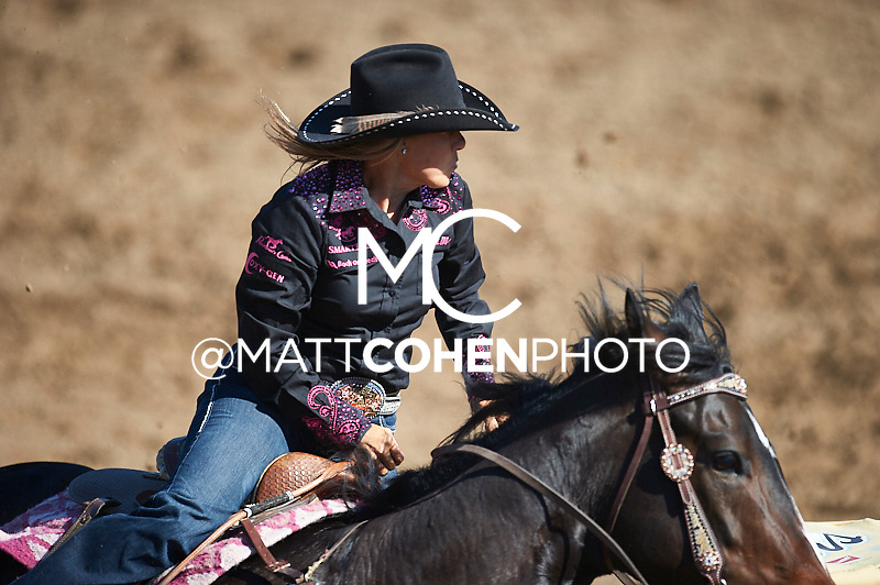 Barrel racer Michele McLeod of Whitesboro, TX competes at the Clovis Rodeo in Clovis, CA.<br /> <br /> <br /> UNEDITED LOW-RES PREVIEW<br /> <br /> <br /> File shown may be an unedited low resolution version used as a proof only. All prints are 100% guaranteed for quality. Sizes 8x10+ come with a version for personal social media. I am currently not selling downloads for commercial/brand use.