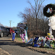 A women cries as she pays her respects to the shrine created under the school sign in Sandy Hook after yesterday's shootings at Sandy Hook Elementary School, Newtown, Connecticut, USA. 15th December 2012. Photo Tim Clayton
