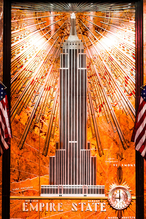 In the Empire State Building's marble-clad lobby, is a spectacular Art Deco bas-relief depicting the building itself, radiating light and energy from its tower