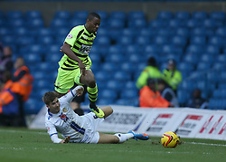 Yeovil Town's Liam Davis leaps over Leeds United's Luke Murphy-Photo mandatory by-line: Matt Bunn/JMP - Tel: Mobile: 07966 386802 02/11/2013 - SPORT - FOOTBALL - Elland Road - Leeds - Leeds United v Yeovil Town - Sky Bet Championship