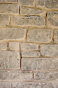 Re-pointing a Cotswolds stone wall using traditional mortaring method, UK