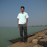 Chakradhar Patra (25) next to the Jambhira dam lake at Mayubhanj dist. Orissa. Resident of Sampura resettlement colony, he is a community volunteer, trained and sensitized by UNDP to facilitate R&R process in effected areas.