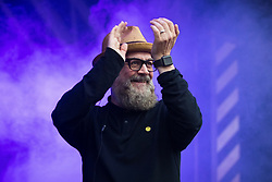 © Licensed to London News Pictures . 01/07/2017 . Manchester , UK . Graeme Park . Hacienda Classical play at the Castlefield Bowl as part of Sounds of the City , during the Manchester International Festival . A collaboration between DJs Mike Pickering and Graeme Park and the Manchester Camerata orchestra , Hacienda Classical reworks music by bands including the Happy Mondays and New Order and features Manchester musicians including Rowetta and Peter Hook . Photo credit : Joel Goodman/LNP