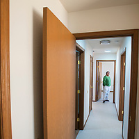 101513       Brian Leddy<br /> Barbara Morgan inspects the bedrooms of a newly renovated home in a Navajo Housing Authority subdivision Tuesday. Morgan is one of several homeowners that had their homes completely remodeled by the NHA.