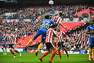 Luke Waterfall of Lincoln City (5) heads the ball away during the EFL Trophy Final match between Lincoln City and Shrewsbury Town at Wembley Stadium, London, England on 8 April 2018. Picture by Stephen Wright.