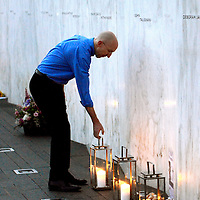 """Tom McMillan of Pittsburgh, places one of the 40 lanterns along the """"Wall of Name""""  at the Flight 93 National Memorial during the Luminaria  Service on the eve of the 14th anniversary of the terrorist attack on America near Shanksville, Pennsylvania on September 10, 2015.  UPI/Archie Carpenter"""