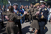 Moscow, Russia, 09/05/2011..Veterans dance with girls in Soviet-era army uniforms as Russian World War Two veterans and well-wishers gather in Gorky Park during the country's annual Victory Day celebrations.