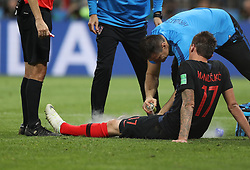 MOSCOW, July 11, 2018  Mario Mandzukic (1st R) of Croatia receives medical treatment during the 2018 FIFA World Cup semi-final match between England and Croatia in Moscow, Russia, July 11, 2018. Croatia won 2-1 and advanced to the final. (Credit Image: © Xu Zijian/Xinhua via ZUMA Wire)