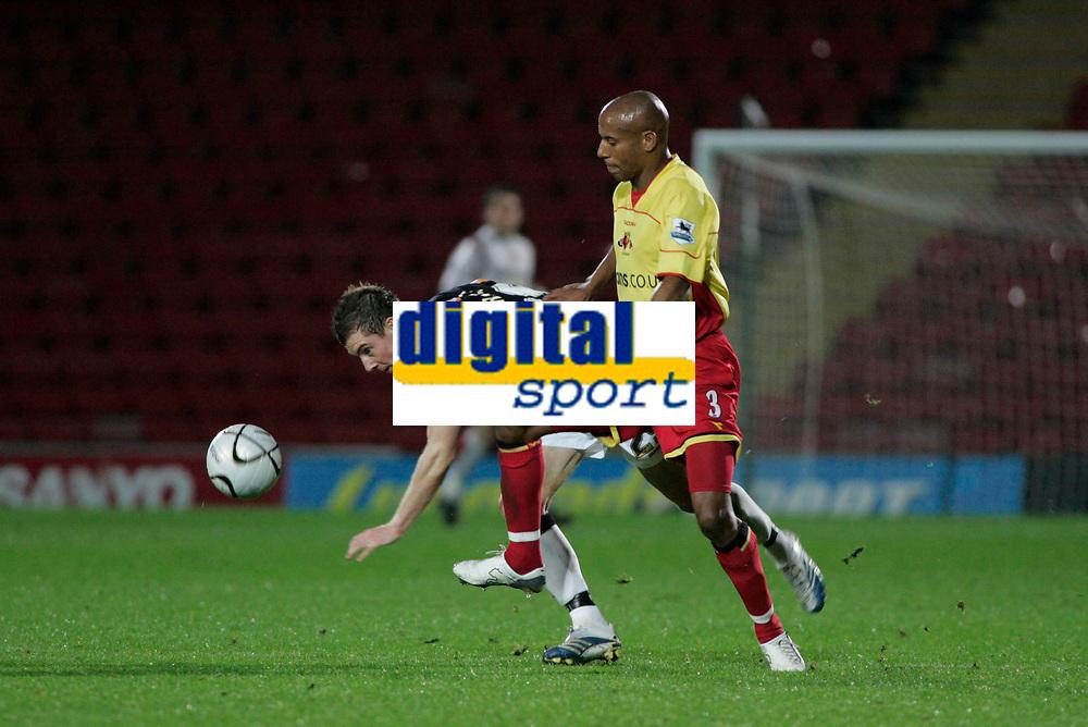 Photo: Marc Atkins.<br />Watford v Hull City. Carling Cup. 24/10/2006.<br />Ryan France of Hull battles with Jordan Stewart of Watford.