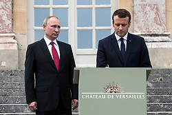 French President Emmanuel Macron and Russian President Vladimir Putin sign the golden book after a visit of an exhibition about Russian emperor Peter the Great at the Grand Trianon after a work meeting at the Versailles Palace near Paris, France, 29 May 2017. This work visit of the Russian President is the first since the Mistral crisis which added to the tensions between France and Russia. Among other subjects the two presidents should talk about the situation in Syria and the constant veto position of the Russian at the UN security council. Photo by Etienne Laurent/Pool/ABACAPRESS.COM
