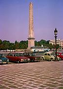 Egyptian obelisk, Place de la Concorde, Paris, France 1967 with parked cars and single decker bus passing