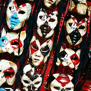 Venetian masks on sale in the narrow alleyways of Venice near Piazza San Marco. Venice, Italy. 1st May 2011. Photo Tim Clayton