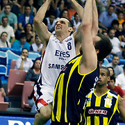 Efes Pilsen's Igor RAKOCEVIC (L) and Fenerbahce Ulker's Lynn Terence GREER (R) during their Turkish Basketball league Play Off Final fifth leg match Efes Pilsen between Fenerbahce Ulker at the Ayhan Sahenk Arena in Istanbul Turkey on Sunday 30 May 2010. Photo by Aykut AKICI/TURKPIX