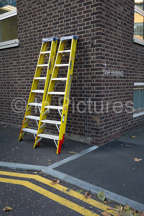 Step ladders are propped up against a wall, at the rear staff entrance of the Tate Modern art gallery, on 13th November 2017, in London, England.