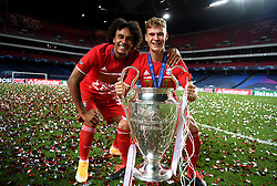 LISBON, PORTUGAL - Sunday, August 23, 2020: FC Bayern Munich's Joshua Zirkzee (L) and Joshua Kimmich celebrate with the European Cup trophy as Bayern win it for the sixth time after the UEFA Champions League Final between FC Bayern Munich and Paris Saint-Germain at the Estadio do Sport Lisboa e Benfica. FC Bayern Munich won 1-0. (Credit: ©UEFA)