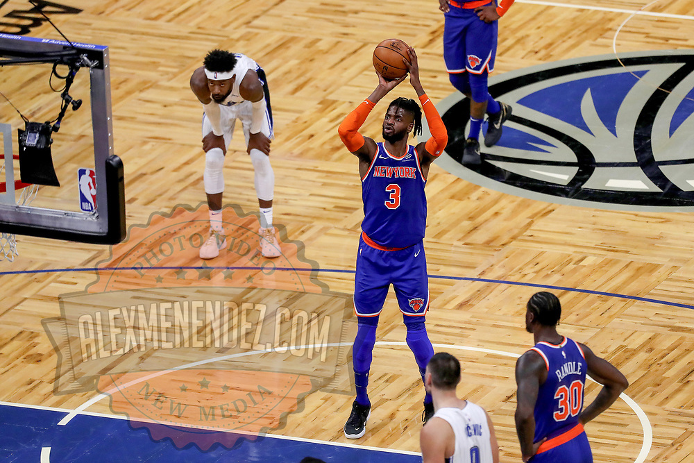 ORLANDO, FL - FEBRUARY 17:  Nerlens Noel #3 of the New York Knicks attempts a free throw against the Orlando Magic at Amway Center on February 17, 2021 in Orlando, Florida. NOTE TO USER: User expressly acknowledges and agrees that, by downloading and or using this photograph, User is consenting to the terms and conditions of the Getty Images License Agreement. (Photo by Alex Menendez/Getty Images)*** Local Caption *** Nerlens Noel