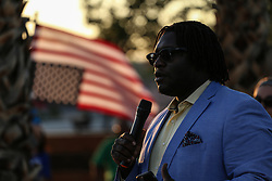 August 13, 2017 - Las Vegas, Nevada, U.S. - ENDER AUSTIN III speaks during a candlelight vigil in solidarity with the victims of Charlottesville at the Martin Luther King Jr. statue in Las Vegas, Nevada. At least three people were killed and 35 injured after a white nationalist rally broke into chaos yesterday in Charlottesville, Virginia. (Credit Image: © Joel Angel Juarez via ZUMA Wire)