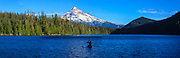 USA, Oregon, Mt. Hood National Forest, Lost Lake, boaters enjoying a summer day on the lake, Digital Composite, panorama.