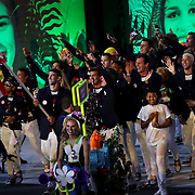 Opening Ceremony 2016 Olympic Games: Michael Phelps carries the USA flag as Ibtihaj Muhammad, (right), marches with the front athletes as they parade in  Maracana stadium during the spectacular opening ceremony for the 2016 Olympic Games on August 5, 2016 in Rio de Janeiro, Brazil. (Photo by Tim Clayton/Corbis via Getty Images)