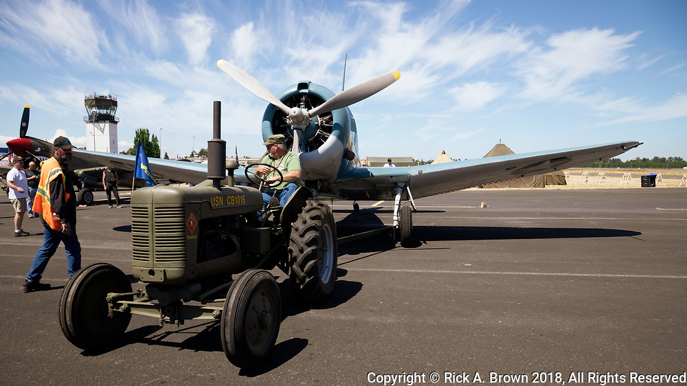 WWII era Navy tractor towing SBD Dauntless at Warbirds Over the West.