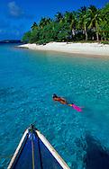 Woman explores a remote island in the Vava'u gropu of islands, Tonga