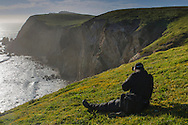 Photographer shooting the Point Reyes headlands is spring, near Chimney Rock, Point Reyes National Seashore, Marin County, California
